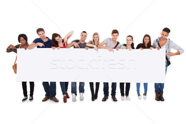 College Students Displaying Blank Billboard Stock photo © AndreyPopov