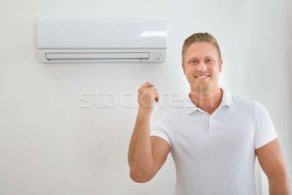 Man With Air Conditioner Remote Control Stock photo © AndreyPopov