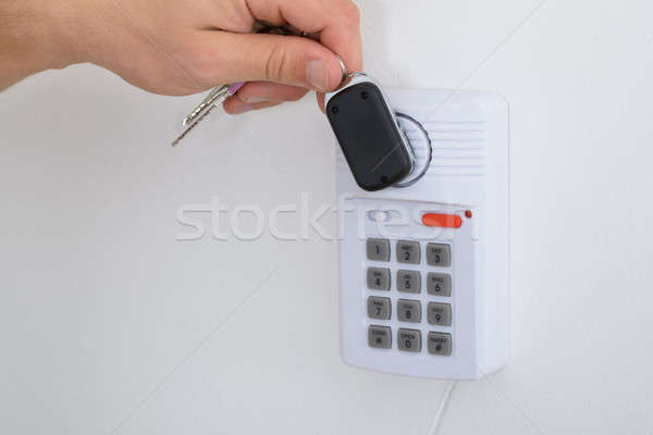 Close-up Of Person Arming A Security System Stock photo © AndreyPopov