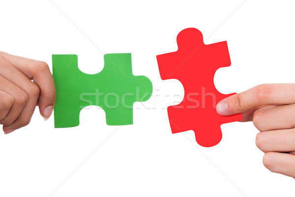 Hands Joining Jigsaw Puzzle Pieces Stock photo © AndreyPopov