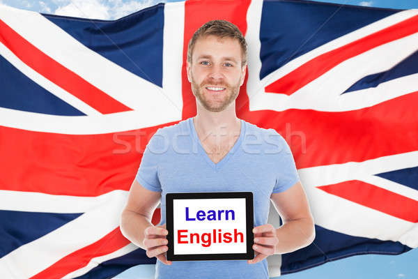 Man Holding Digital Tablet With Learn English Text Stock photo © AndreyPopov