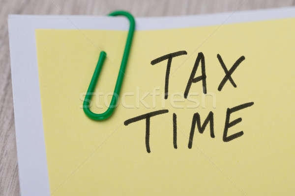 Tax Time Written On Yellow Note Stock photo © AndreyPopov