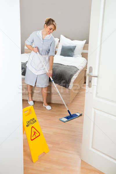 Maid Cleaning Floor With Mop Stock photo © AndreyPopov