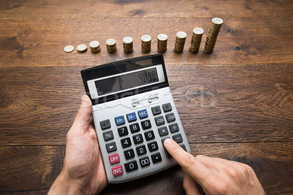 Businessman Doing Calculations Stock photo © AndreyPopov