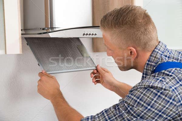 Repairman Repairing Kitchen Extractor Filter Stock photo © AndreyPopov