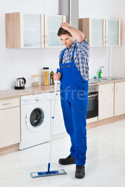 Worker Cleaning Floor With Mop Stock photo © AndreyPopov