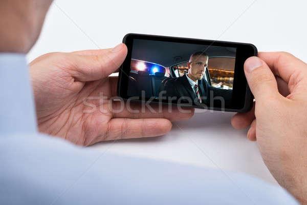 Persona guardare video cellulare primo piano mano Foto d'archivio © AndreyPopov