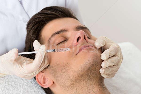Doktor enjeksiyon yüz adam eldiven Stok fotoğraf © AndreyPopov