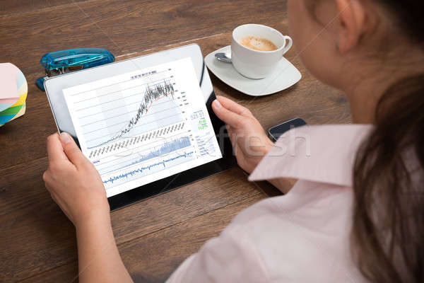 Businesswoman Analyzing Graph On Digital Tablet Stock photo © AndreyPopov
