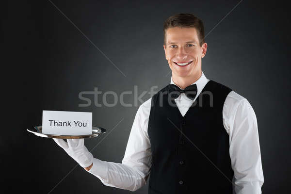 Waiter With Thank You Sign Stock photo © AndreyPopov