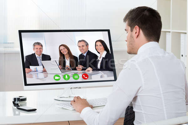 Businessman Videoconferencing On Desktop Computer Stock photo © AndreyPopov