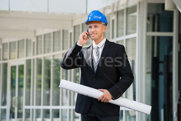 Engineer With Blue Print Talking On Cellphone Stock photo © AndreyPopov