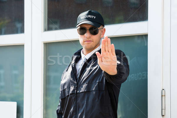 Stock photo: Male Security Guard Making Stop Sign With Hand