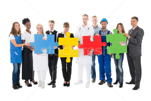 Confident People With Various Occupations Holding Jigsaw Pieces Stock photo © AndreyPopov