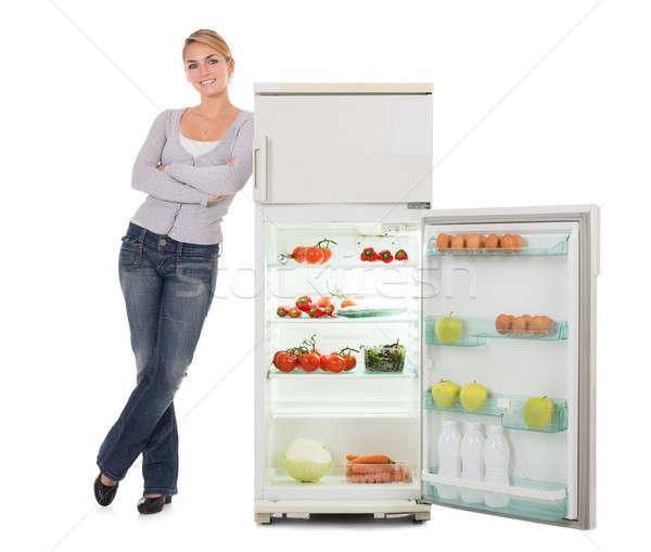 Femme ouvrir réfrigérateur portrait Photo stock © AndreyPopov