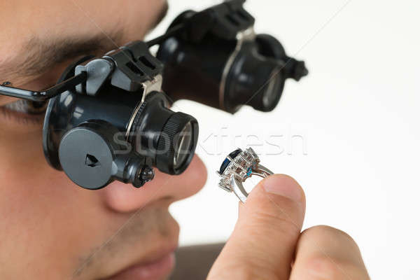 Jeweler Examining Diamond Ring With Magnifying Loupe Stock photo © AndreyPopov