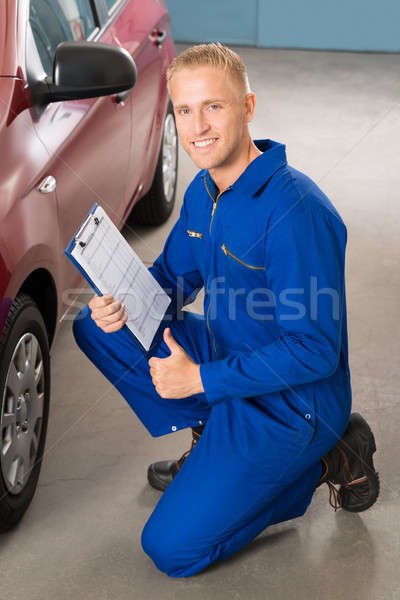 Mechanic Holding Clipboard Stock photo © AndreyPopov