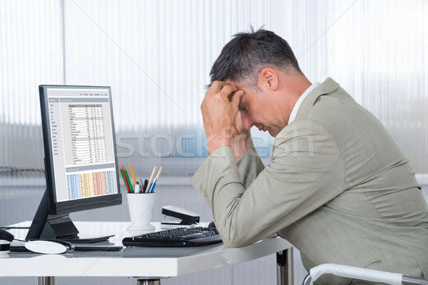 Accountant Suffering From Headache At Desk Stock photo © AndreyPopov