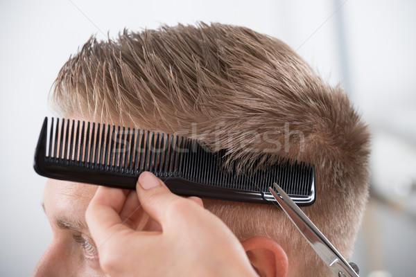 Hombre peluquero salón joven femenino Foto stock © AndreyPopov