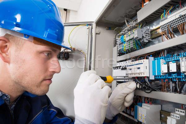 Male Electrician Examining Fusebox Stock photo © AndreyPopov