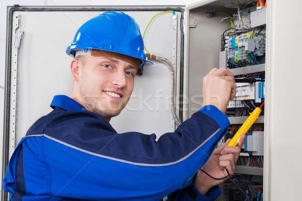 Male Technician Examining Fusebox Stock photo © AndreyPopov