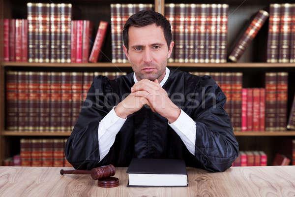 Grave juez pensando sesión escritorio retrato Foto stock © AndreyPopov