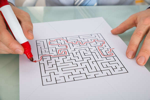 Person Hand Solving Maze Puzzle Stock photo © AndreyPopov