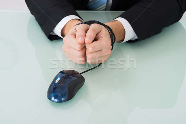 Person Wrist Bound By Computer Mouse Cable Stock photo © AndreyPopov