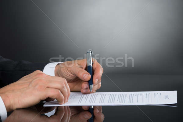 Close-up Of Businessperson Signing Contract Paper With Pen Stock photo © AndreyPopov