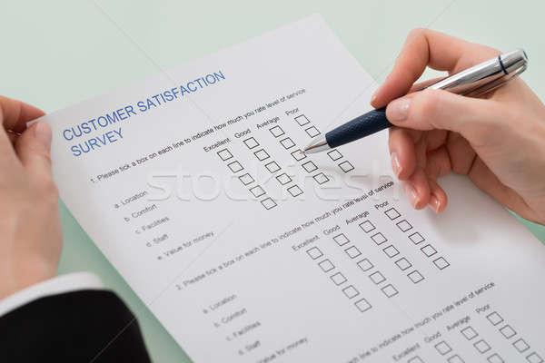 Woman Filling Customer Satisfaction Form Stock photo © AndreyPopov