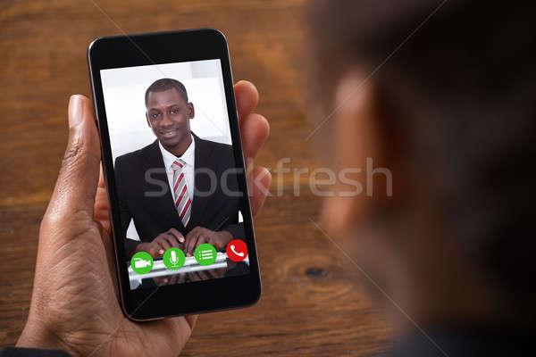 Businesswoman Videochatting On Mobile Phone Stock photo © AndreyPopov