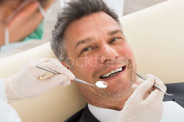 Man Having Dental Check-up In Clinic Stock photo © AndreyPopov