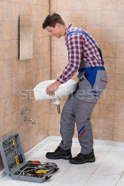 Male Plumber Installing Sink In Bathroom Stock photo © AndreyPopov