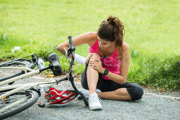 Young Woman Fallen From Bicycle Stock photo © AndreyPopov