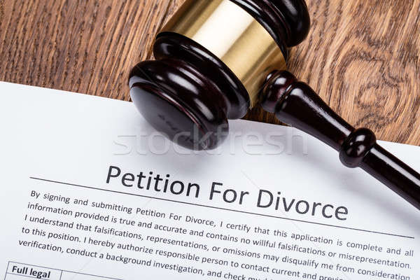 Wooden Gavel On Petition For Divorce Paper Stock photo © AndreyPopov