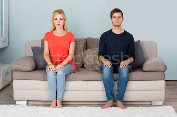 Shy Couple Sitting On Sofa Stock photo © AndreyPopov