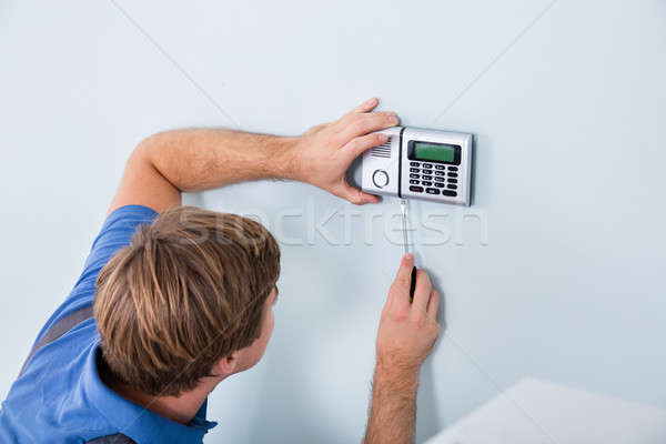 Repairman Fixing Security System Stock photo © AndreyPopov