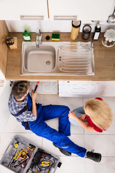 High Angle View Of Male Worker Repairing Kitchen Sink Stock photo © AndreyPopov