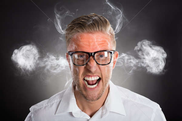Dühös fiatal üzletember piros homlok füst Stock fotó © AndreyPopov