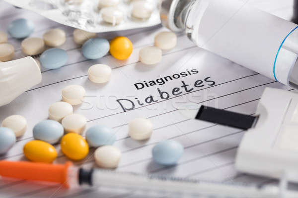 Diabetes Text On Paper With Pills;Vial And Syringe Stock photo © AndreyPopov