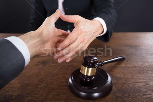 клиент судья рукопожатием другой молоток Сток-фото © AndreyPopov