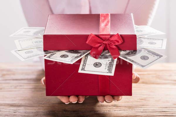 Woman Holding Gift Box Of Us Dollar Bills Stock photo © AndreyPopov
