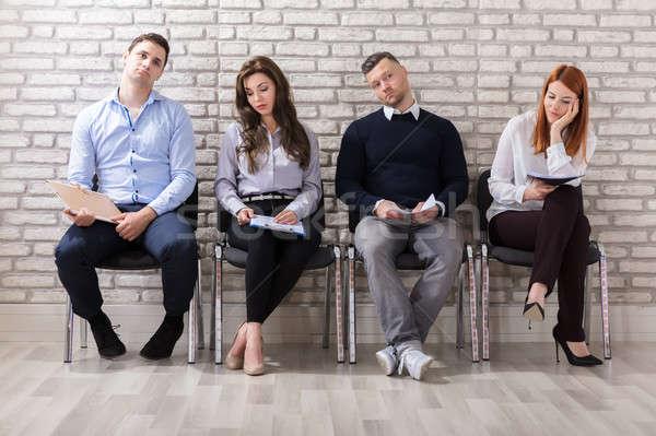 Aburrimiento espera gente de negocios aburrido sesión Foto stock © AndreyPopov