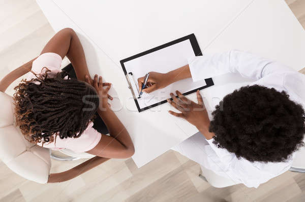 Stock photo: High Angle View Of Doctor And Patient