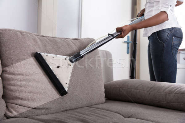 Housewife Cleaning Sofa With Vacuum Cleaner Stock photo © AndreyPopov