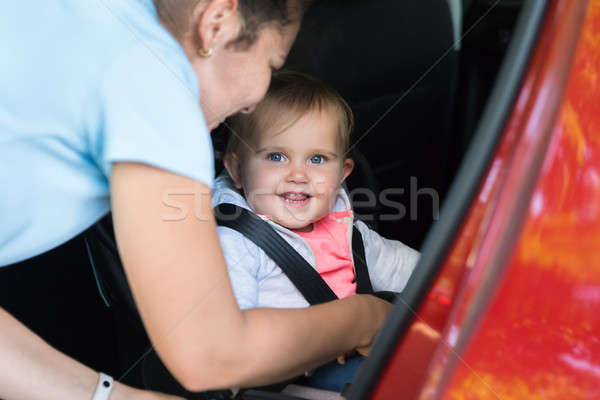 Mother Taking Care Of Her Baby In Car Stock photo © AndreyPopov