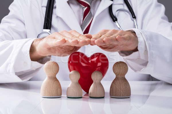 Orvos család orvosok kéz fából készült piros Stock fotó © AndreyPopov