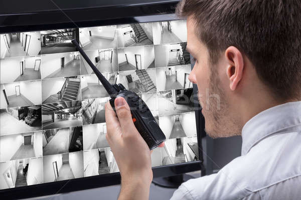 Security Guard Monitoring CCTV Footage Stock photo © AndreyPopov