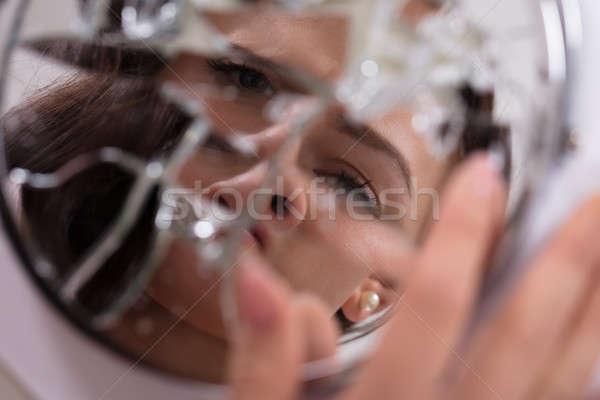 Woman's Face In Broken Mirror Stock photo © AndreyPopov