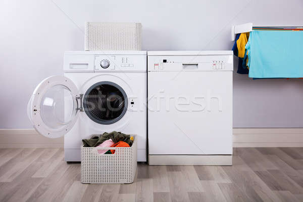 Empty Washing Machine With Pile Of Dirty Clothes Stock photo © AndreyPopov